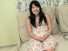 This innocent-looking asian babe spreads her long legs wide open