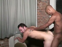 Tattooed white guy fucked by black cock