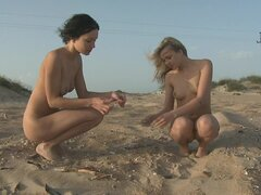 Sporty women walk naked on beach