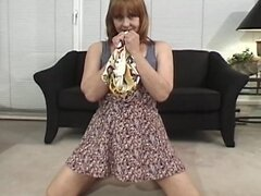 Mature redhead with hairy muff has difficulty sucking huge chode in living room