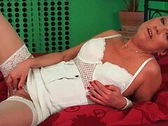 Grandma in white stockings enjoys hard cock