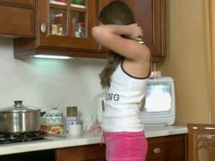 Adorable Teen Playing With Her Dildo In The Kitchen