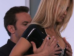 She's dressed in hot latex and he feels her up and licks her cunt