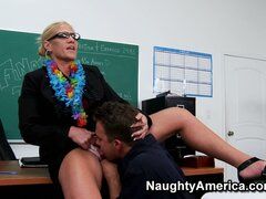 Mature blonde teacher Amber Irons teaches her naughty student how to lick pussy