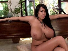 Brunette Leanne Crow is showing off her nasty boobies