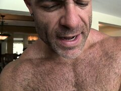 Horny masseur works his gay clients cock and balls like a master
